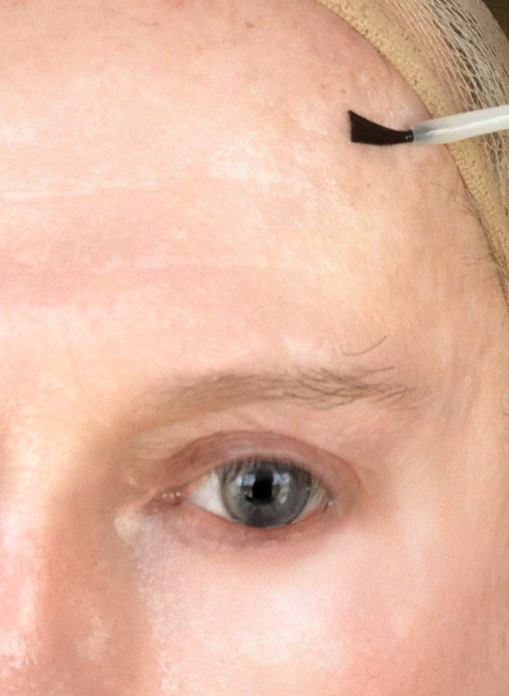 Nu Skin applied in preparation for crossdresser makeup brow arch